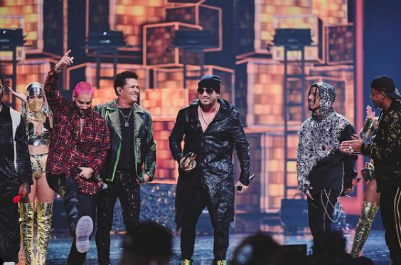 artists together on stage at award show