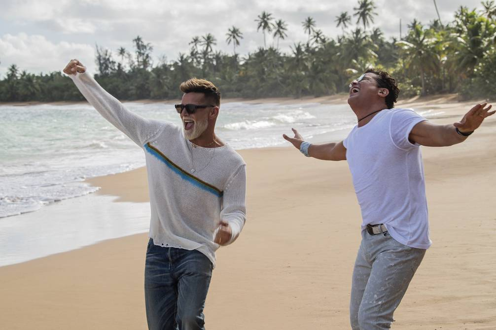 Two men dancing on the beach